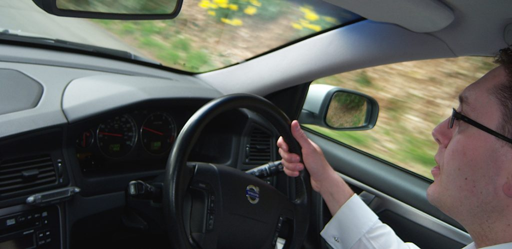 A driver at work in an executive car